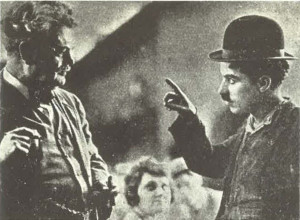 Redmond (left) and Chaplin (right) on the set of A Dog's Left (1918)